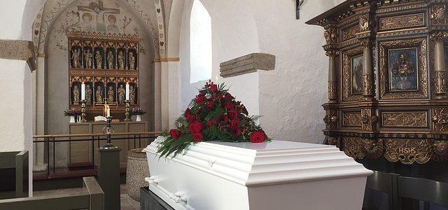 white coffin in church