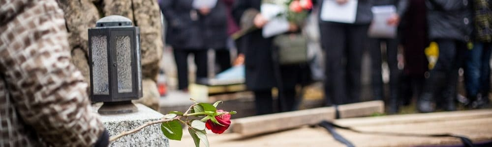 family gathered at funeral burial