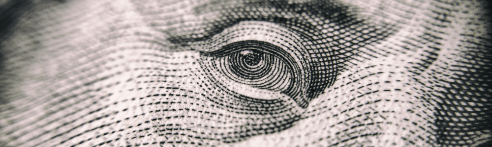 close up of Benjamin Franklin on the 100 dollar bill